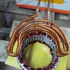 cambered induction coil for heating copper wire heads