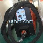 UM-20A-UHF with flexible handheld induction coil for jointing